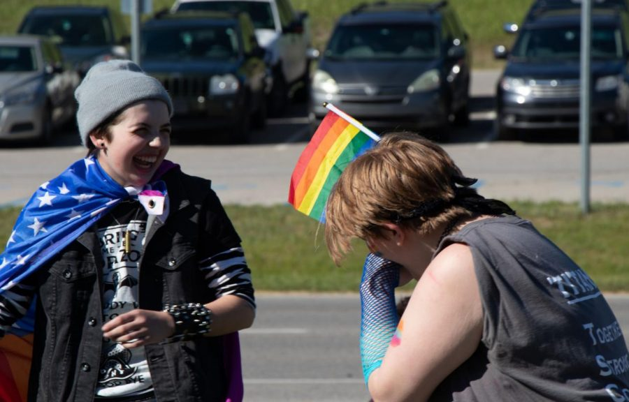 Sophomore Quincy Ward shares a laugh with a peer during the student walk out on June 1