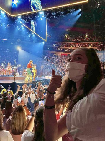 Sophomore Ava Hellem posing in front of Styles in Detroit Monday, Sept. 20. Hellem worked a summer job specifically to pay for her ticket to this concert. Photo courtesy: A. Hellem