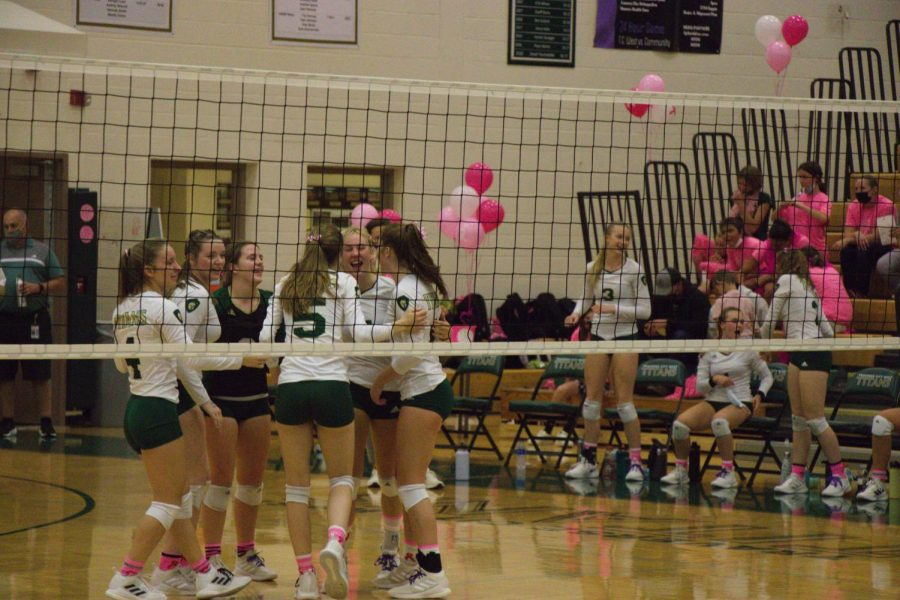 The varsity volleyball girls circle up in excitement after their win. Photo: P. Worden/staff